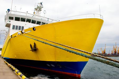 oceanic: A big yellow oceanic ship by the wharf Stock Photo