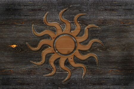 An illustration of a wood-carving Sun sign Stock fotó