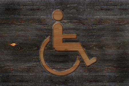 An illustration of a wooden carved wheelchair sign. illustration