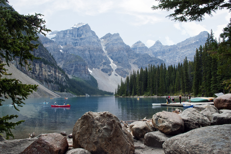Kayaks on Moraine Lake , Banff National Park, Alberta, Canada photo
