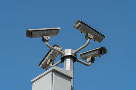 private security: Cameras mounted on the pole to oversee city Stock Photo