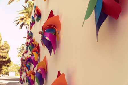colorful windmills on the wall