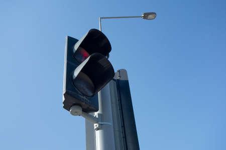 blue sky red traffic light
