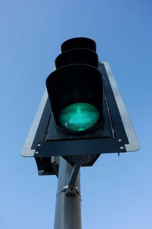 blue sky green traffic light