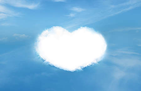Blue sky and heart shaped clouds Stock Photo