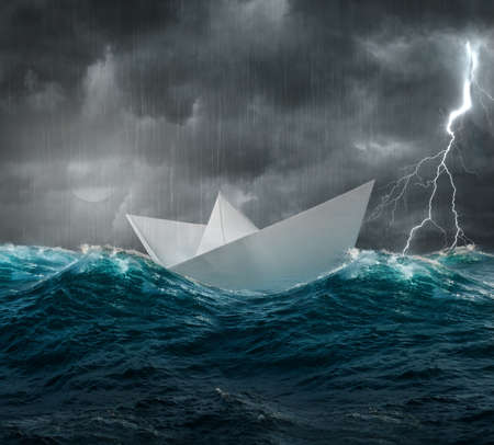 stormy sea and paper ship