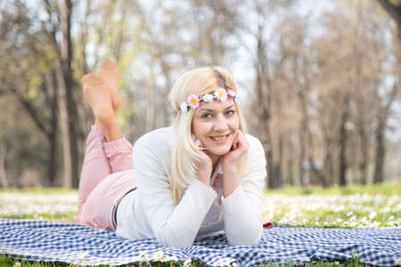 comercial: Beautiful teen blonde girl in park with flowers