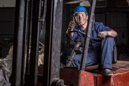 junkyard: Junkyard worker Stock Photo
