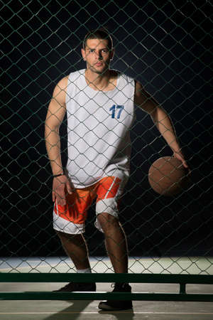 dribbling: Young man on basketball court dribbling with ball. Streetball, training, activity