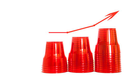 Concept of rising plastic consumption. Red plastic cups, isolated background