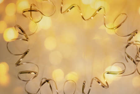 Festive background of ribbon, glitters and bokeh on white background. Copy space.