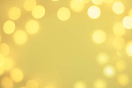 Abstract pastel blurred golden sparkling festive bokeh background 版權商用圖片