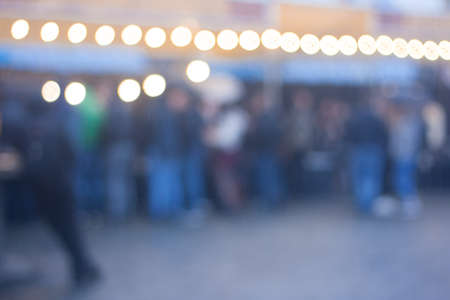 Blurred image of crowded street food festival background in the evening