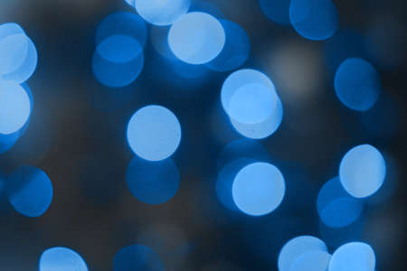 Blue 2020 color abstract background with bokeh defocused lights. Trend