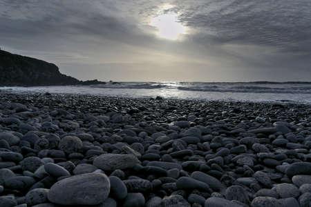 pebble: pebble beach at sunset