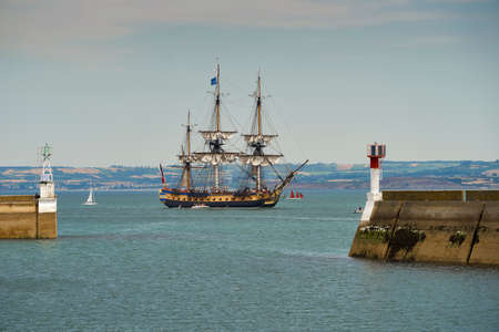 frigate: Douarnenez, France - July 19, 2016. French light frigate Hermione replica sailing into the harbor for the maritime festival