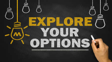 explore your options on blackboard background Stock Photo