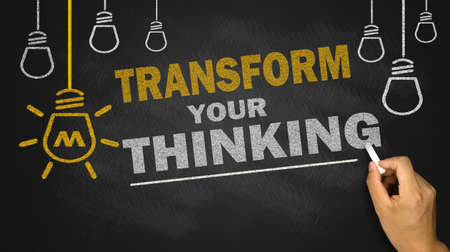 transform your thinking on blackboard background