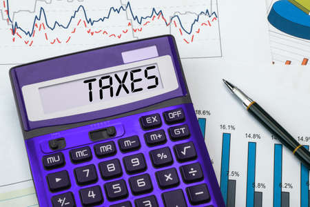 withhold: taxes concept displayed on calculator Stock Photo