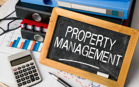 property management: the words of property management written on blackboard Stock Photo
