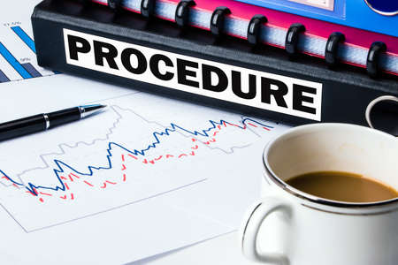 management process: procedure on business document folder Stock Photo