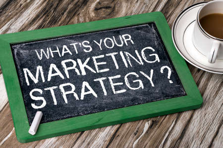 the words of what is your marketing strategy question handwritten on blackboard