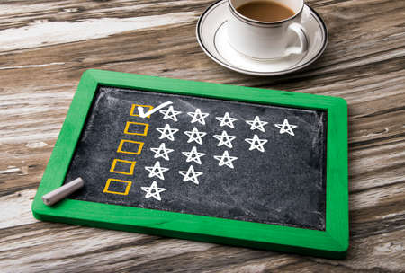 rating: five star rating concept on blackboard