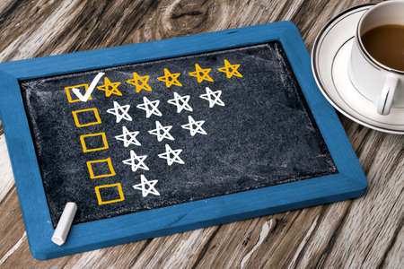customer satisfaction: five star rating concept on blackboard