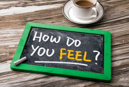 by feel: how do you feel handwritten on blackboard Stock Photo