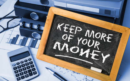 reduce taxes: keep more of your money concep on blackboard