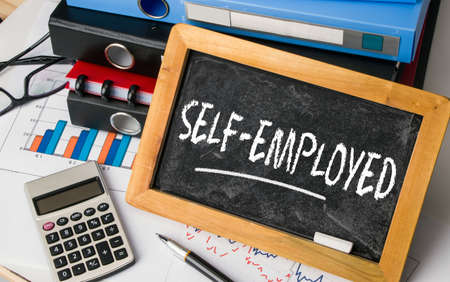 selfemployed: self-employed handwritten on blackboard