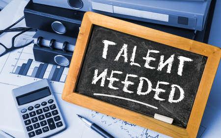 needed: talent needed concept on blackboard Stock Photo