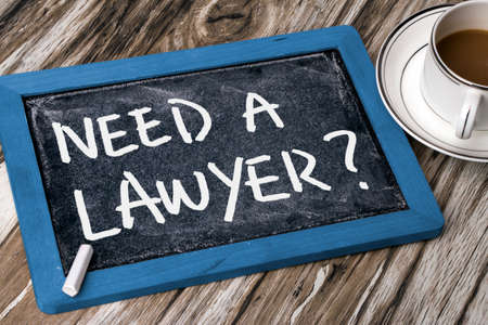 solicitor: need a lawyer handwritten on blackboard Stock Photo
