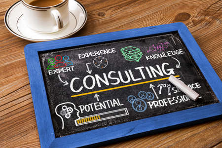 professional development: consulting concept chart with business elements on blackboard