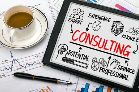 consulting concept chart with business elements on tablet pc Standard-Bild