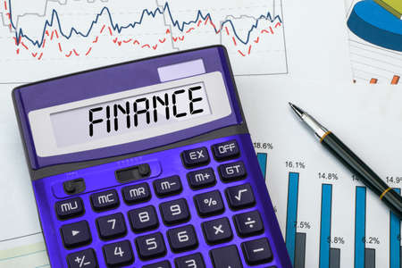 money management: finance concept displayed on calculator Stock Photo