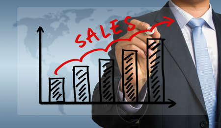 sales graph concept hand drawing by businessman