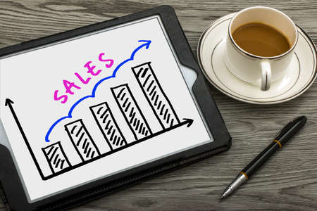 sales person: sales graph concept hand drawing on tablet pc Stock Photo