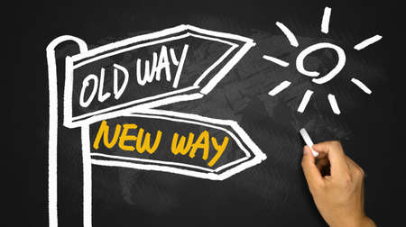 new way: new way or old way concept signpost hand drawing on blackboard