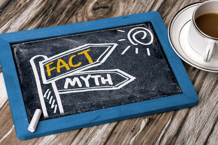 fact: fact and myth concept signpost hand drawing on blackboard Stock Photo