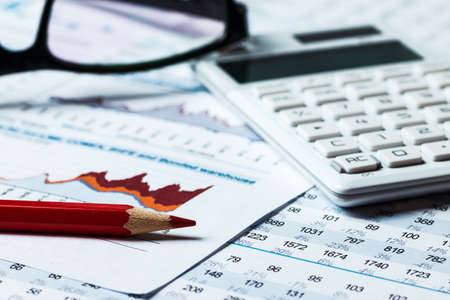 Financial accounting graphs and charts analysis Foto de archivo