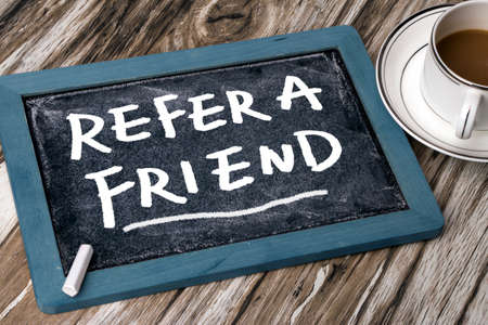 refer a friend concept on blackboard