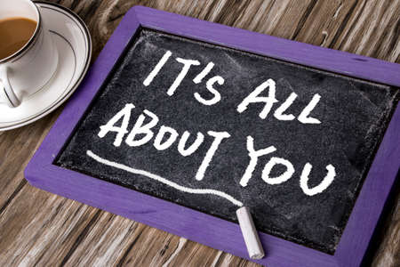 about you: its all about you on small blackboard Stock Photo