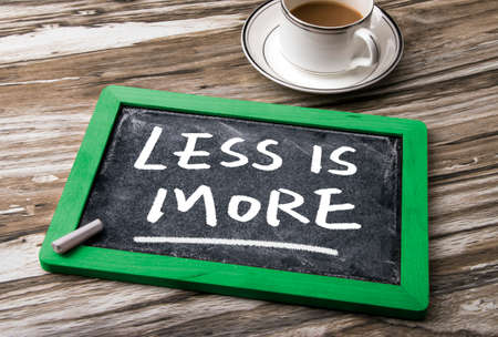 less: less is more on blackboard Stock Photo