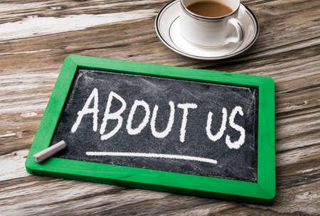about us: about us handwritten on blackboard