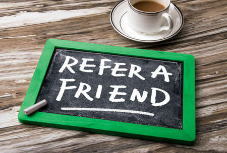 refer: refer a friend concept on blackboard
