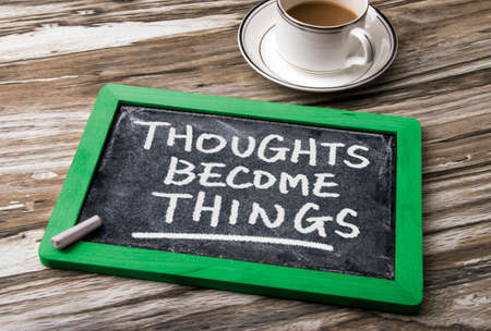 become: thoughts become things handwritten on blackboard Stock Photo