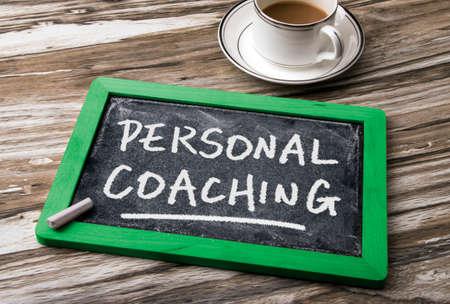 personal coaching handwritten on blackboard