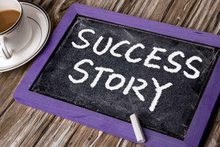 business advice: success story handwritten on blackboard Stock Photo