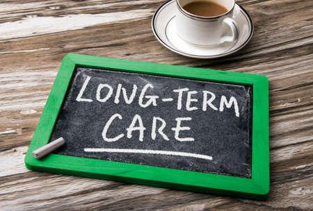 long-term care handwritten on blackboard